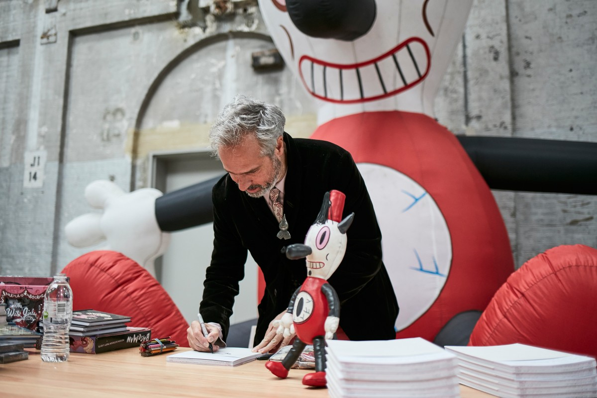 Crowd favourite Gary Baseman signing with Toby (inflatable and doll)